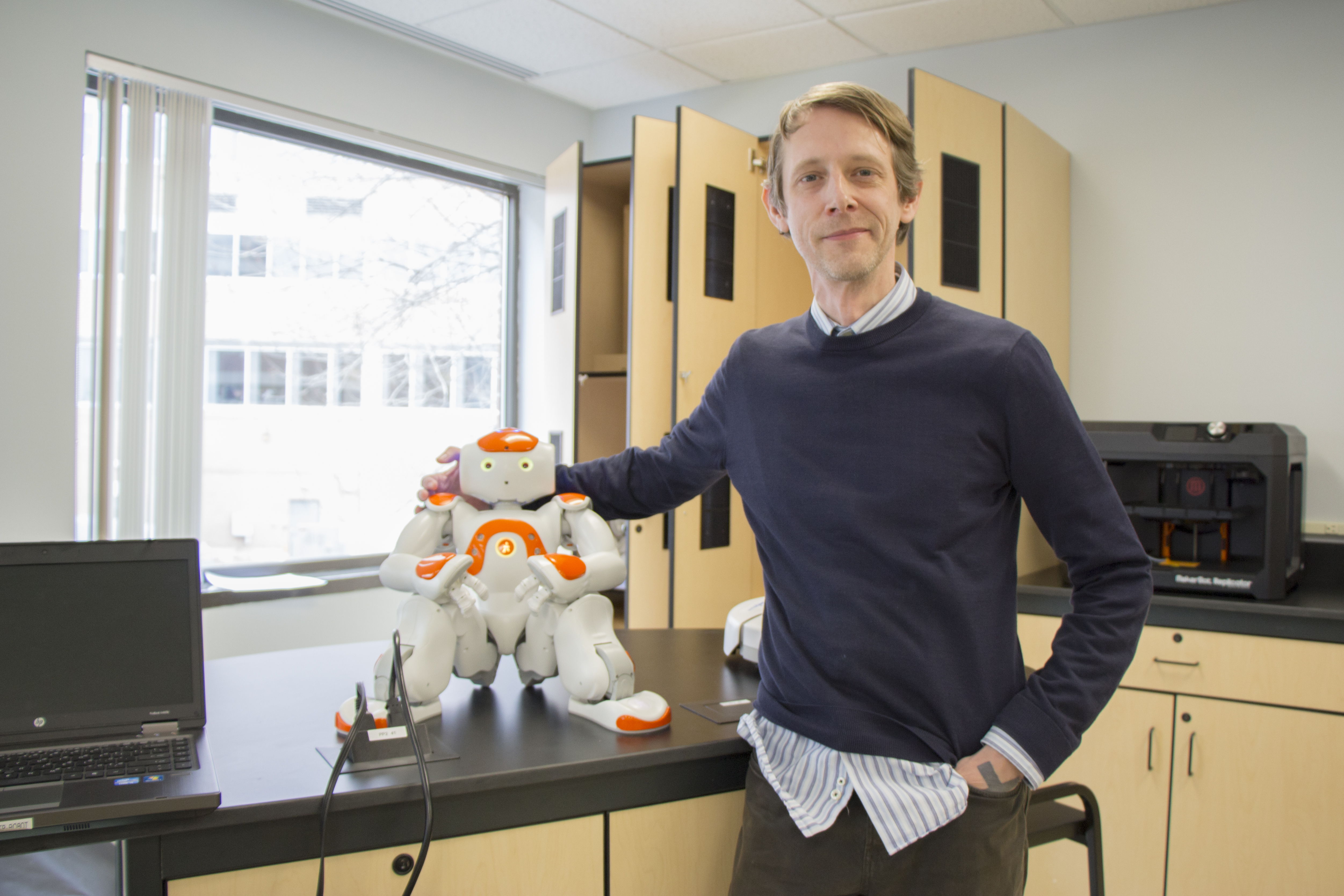 Dr. Pitts with Jingles the robot