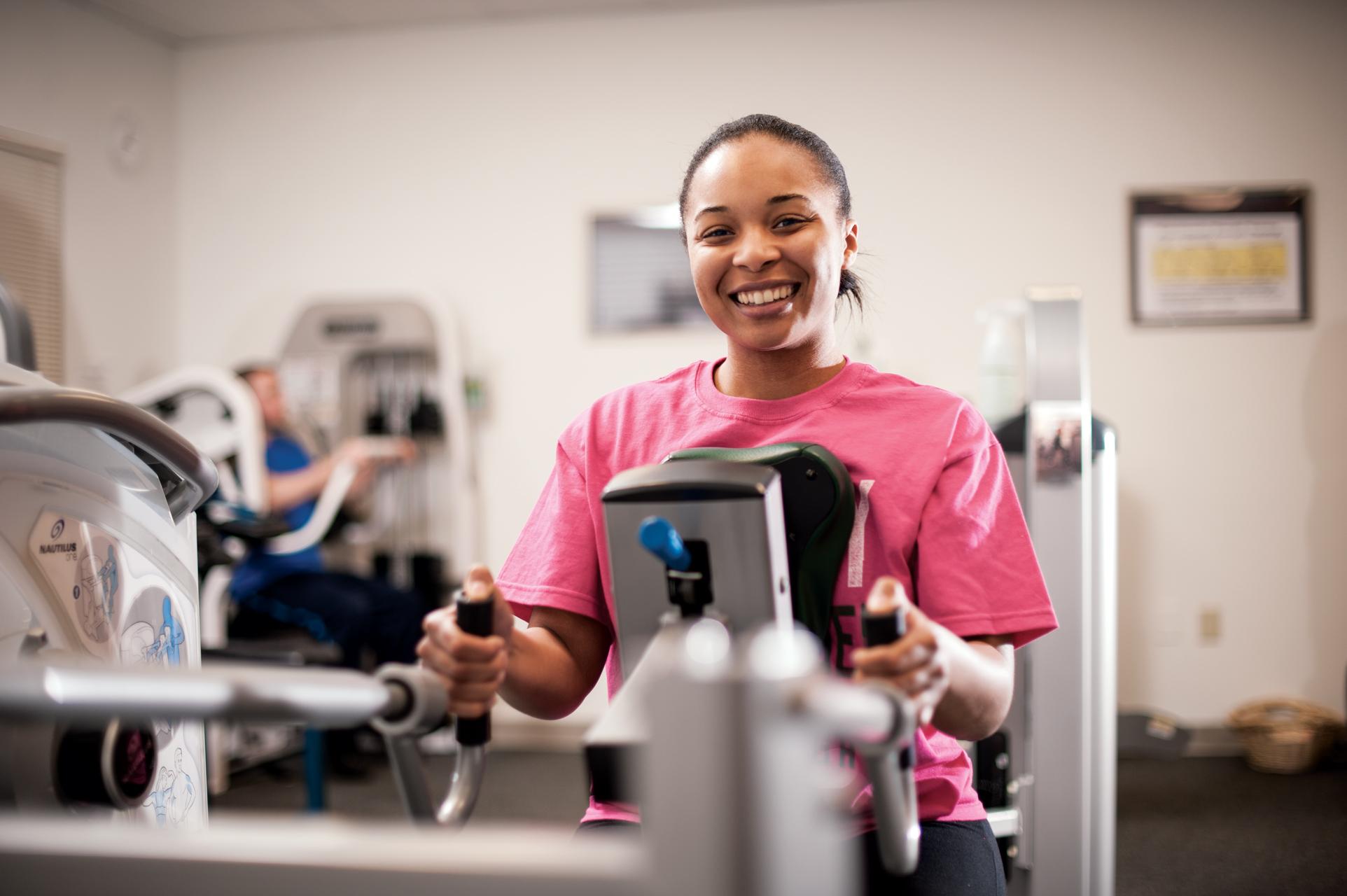 Female on Exercise Equipment